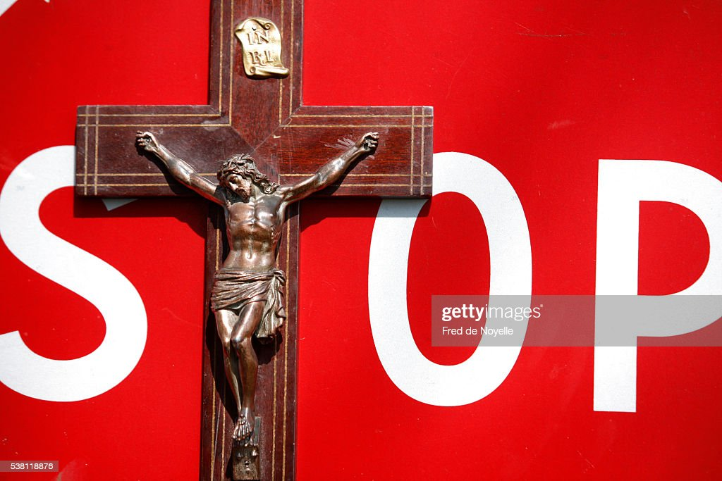 Crucifix and Stop Sign : Stock Photo