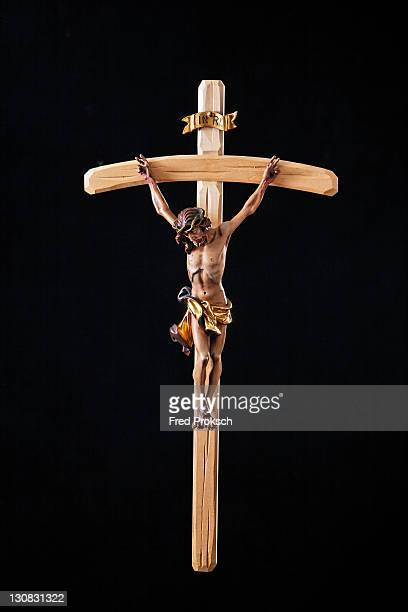 crucifix, christian symbol - death and resurrection of jesus stock photos and pictures