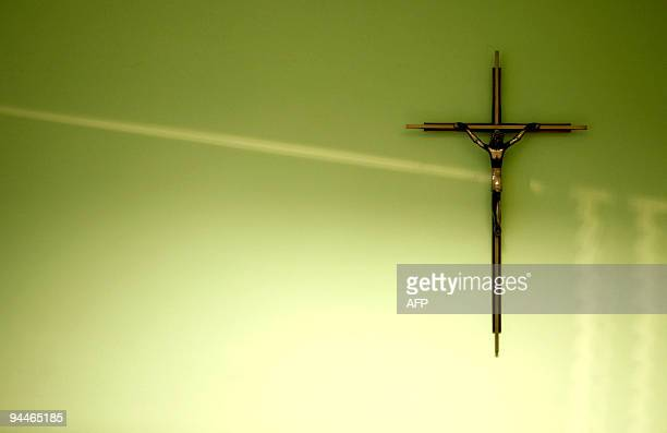 A crucifix hangs on the wall of a classroom in a school of the city of Burgos northern Spain on December 4 2009 Spain has taken the first step...