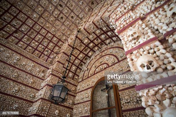 crucifix in capela dos ossos - chapel stock pictures, royalty-free photos & images