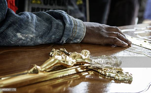 A crucifix is seen as people wait in front of morgue of Chiromo Campus of Nairobi University on April 04 2015 to identify the corps of their...