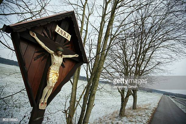 Crucifix is seen beside a snowy field on March 20, 2008 near Eresing, Germany. The weather forecasts predict wet, rainy and regional snowy weather...