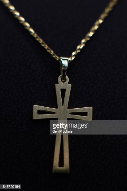 A crucifix necklace is displayed at Sharps Pixley Bullion Brokers on December 15 2015 in London England The brand established in 1778 is owned by the...