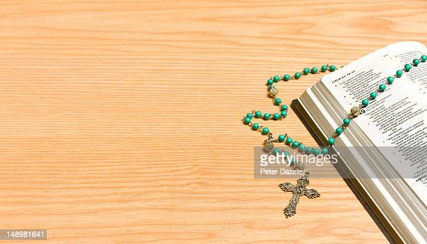 crucifix on bible, with copy space - bible stock pictures, royalty-free photos & images