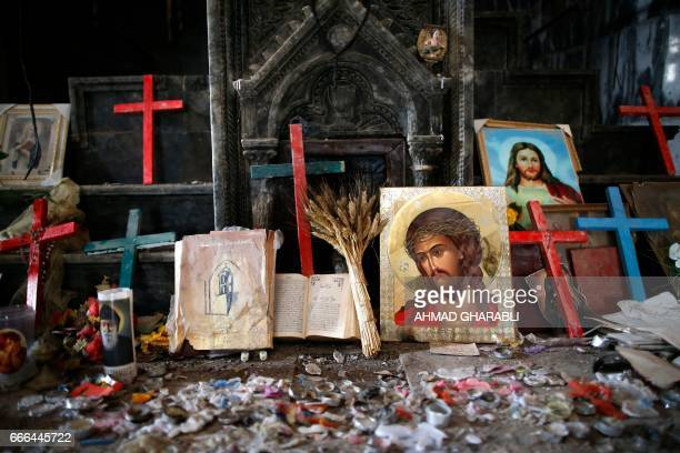 Crucifixes and icons are seen at the heavily damaged Church of the Immaculate Conception in Qaraqosh , some 30 kilometres east of Mosul, on April 9...