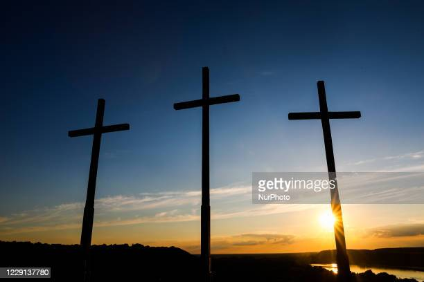 Crucifixes are seen during the sunset on The Three Cross Hill in Kazimierz Dolny, Poland on September 3, 2020.