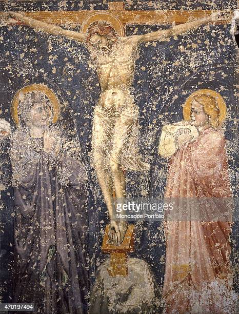 Crucifixion by Artist from northern Italy 14th century fresco Italy Veneto Trevisto Church of St Catherine Whole artwork view Crucified Christ with...
