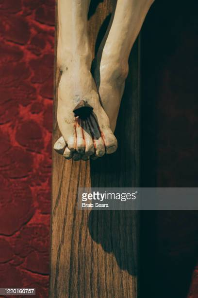 crucifixion - feet torture stock pictures, royalty-free photos & images