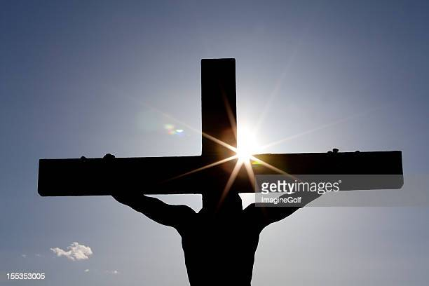 crucifixion silhouette - death and resurrection of jesus stock photos and pictures