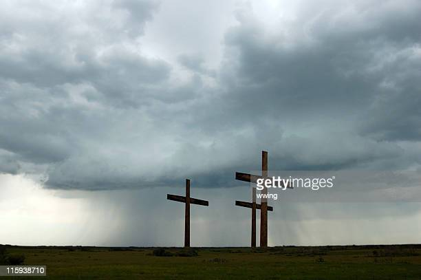 crucifixion with approaching storm - good friday stock pictures, royalty-free photos & images