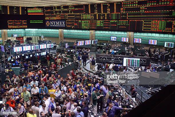 Crude oil and natural gas traders work on the floor of the New York Mercantile Exchange during afternoon trading October 24 2008 in New York City As...