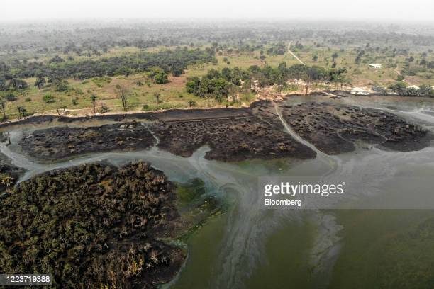 Crude oil pollutes the waters of an estuary in this aerial photograph taken over B-Dere, Ogoni, Nigeria, on Saturday, Feb. 1, 2020. Nigerians from...
