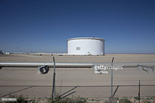 A crude oil storage tank stands in the Permian Basin near Orla Texas US on Friday March 2 2018 Chevron the world's thirdlargest publicly traded oil...