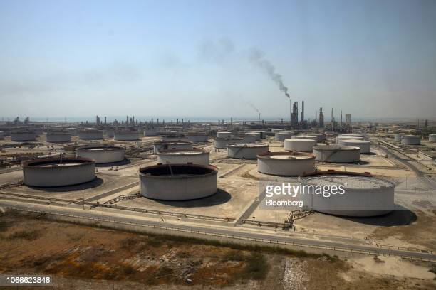 Crude oil storage tanks at the Juaymah Tank Farm in Saudi Aramco's Ras Tanura oil refinery and oil terminal in Ras Tanura Saudi Arabia on Monday Oct...