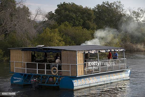 Cruise along the Victoria Falls aboard the ' African Queen' Other boats sailing in the Zambezi River The sunset cruises vary in boat size _ from...