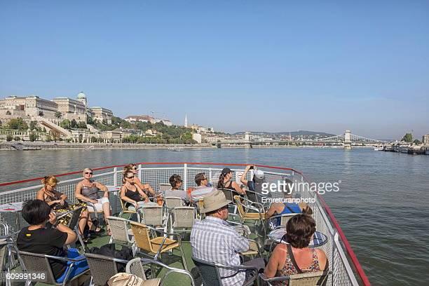 cruise boat along river danube - emreturanphoto stock-fotos und bilder