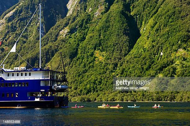 Cruise boat and kayaks on Doubtful Sound.