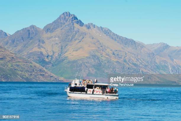 Cruise boat on Lake Wakatipu before The Remarkables mountain range.