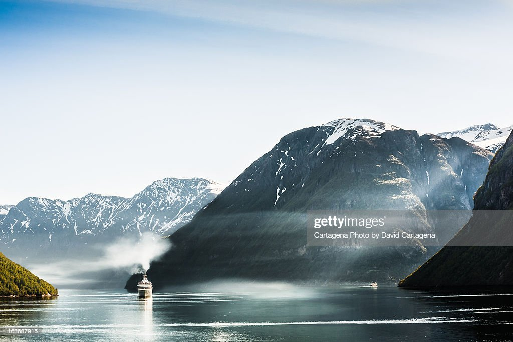 Cruise boat passes Geiranger fjord : Stock Photo