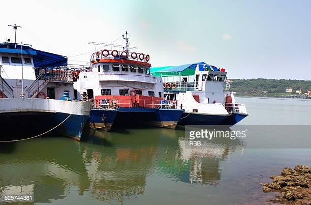 cruise boats in mandavi river in panaji, goa. - panjim stock photos and pictures