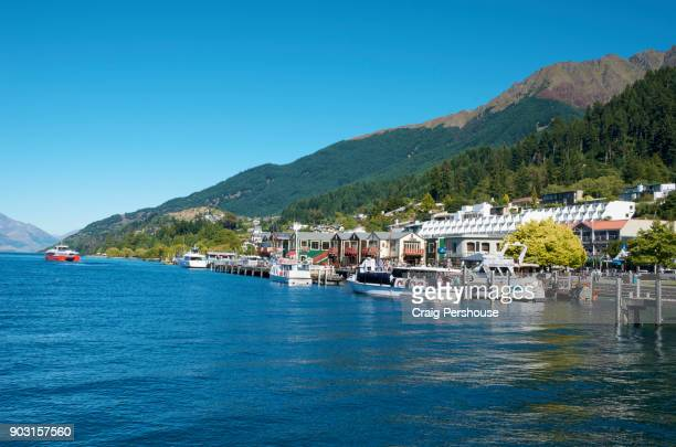cruise boats in queenstown bay. - otago region stock pictures, royalty-free photos & images