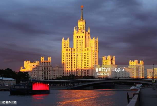 Cruise boats sail along the Moscow river near the Kotelnicheskaya embankment building in Moscow Russia on Wednesday July 5 2017 US officials...