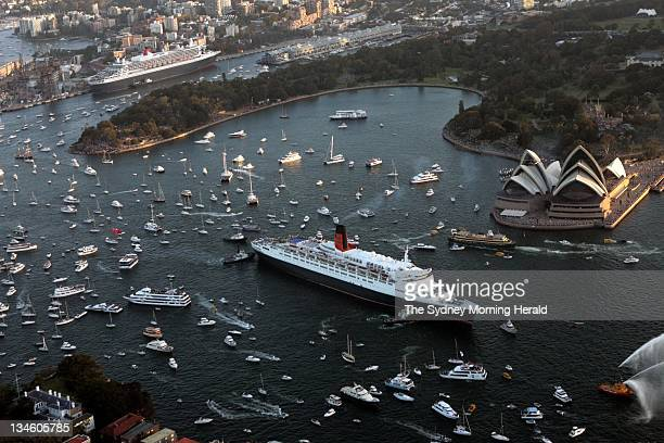 Cruise liner the Queen Elizabeth 2 making her way through Sydney Harbour for a brief reunion with her sister ship the Queen Mary 2 20 February 2007