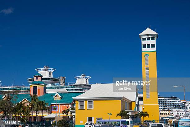 cruise liners moored in port of nassau, bahamas - nassau stock photos and pictures