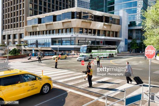 cruise passenger in crosswalk near canada place, vancouver - transportation occupation stock pictures, royalty-free photos & images
