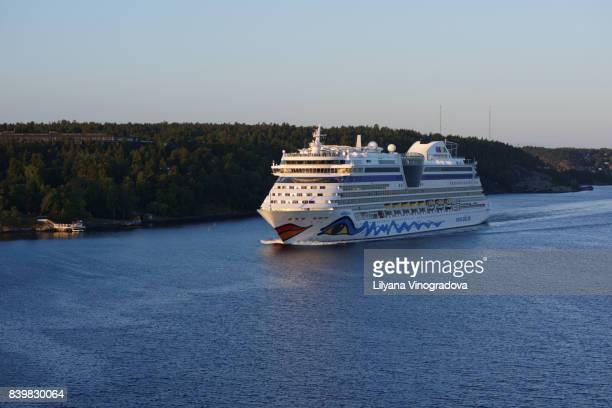 Cruise ship AIDAdiva at Stockholm archipelago in a summer morning