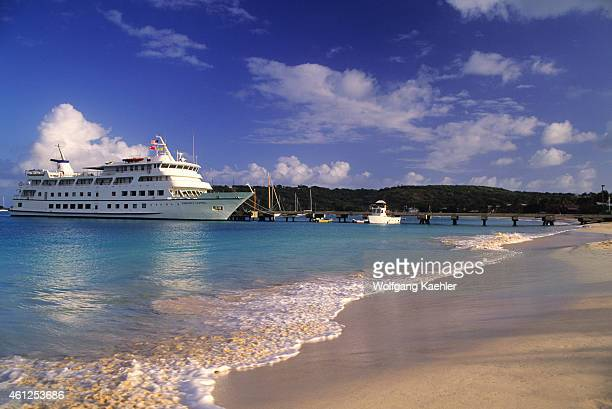 Cruise ship Americana docked in Anguilla with a white sand beach in foreground
