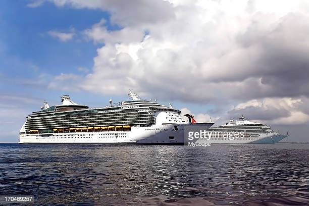 Cruise ship anchored off the shore of Grand Cayman Island Royal Caribbean cruise liner Mariner of the Sea and Carnival Cruise Liner turning to return...