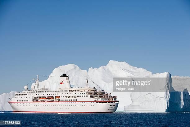 Cruise ship and iceberg with hole