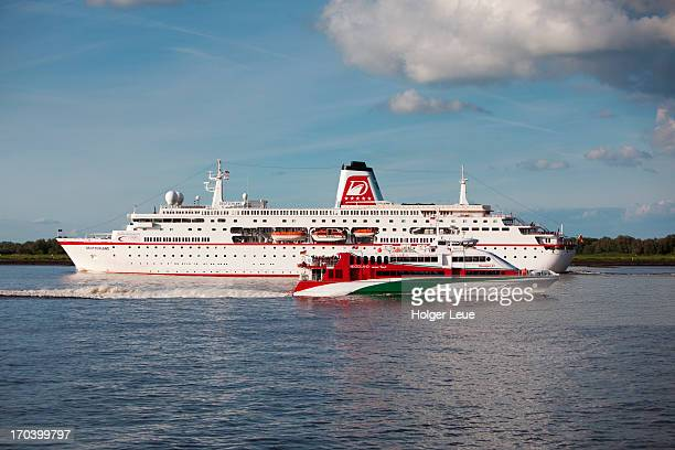 cruise ship and  jet - helgoland stock pictures, royalty-free photos & images