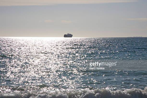 Cruise ship at horizon above sun reflected waters of the Mediterranean Sea off Almeria, Andalusia, Spain