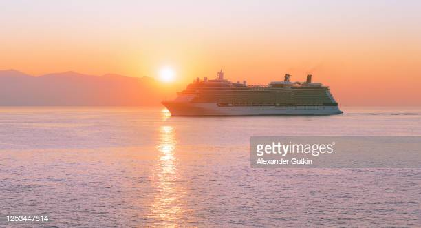 cruise ship at sea at sunrise - cruise ship stock pictures, royalty-free photos & images