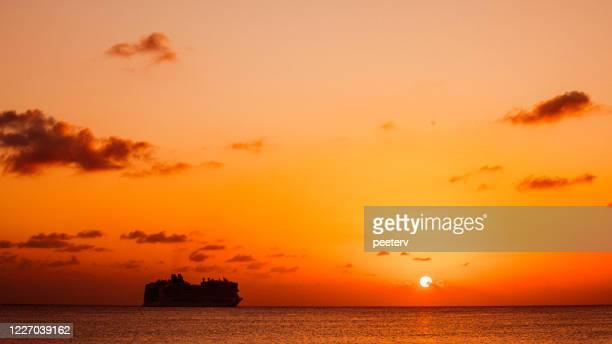 "cruise ship at sunset - bridgetown, barbados - ""peeter viisimaa"" or peeterv stock pictures, royalty-free photos & images"