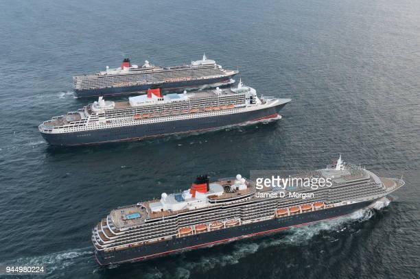 Cruise ship company Cunard execute a photo shoot with all three of its ships Queen Mary 2 and Queen Elizabeth and Queen Victoria either side on May...