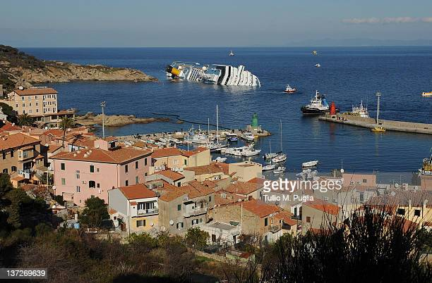 Cruise ship Costa Concordia lies stricken off the shore of the island of Giglio at Giglio Porto on January 18 2012 in Giglio Porto Italy The official...