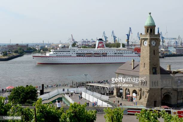 Cruise ship MS Deutschland arrives off of the Landungsbruecken in Hamburg Germany 02 August 2014 There will be fireworks in the port tonight as part...