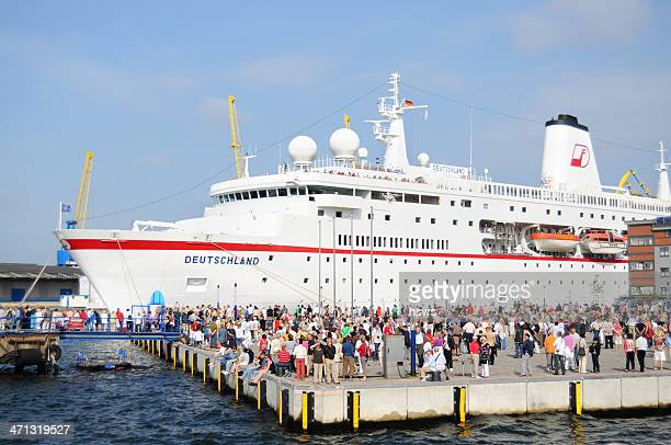cruise ship deutschland at old wood harbor of wismar (germany) - passenger craft stock pictures, royalty-free photos & images
