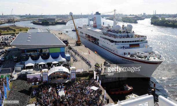 Cruise ship MS Deutschland docks at the port of Hamburg with more than 200 members of the German Olympic Team 2012 on board in Hamburg northern...