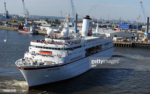 Cruise ship MS Deutschland enters the port of Hamburg with more than 200 members of the German Olympic Team 2012 on board in Hamburg northern Germany...