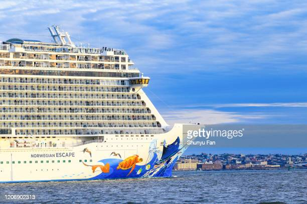 cruise ship escape at new york city - traditionally norwegian stock pictures, royalty-free photos & images