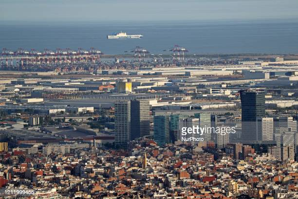 A cruise ship in front the port Barcelona reaches historic lows in air pollution on 06th May 2020