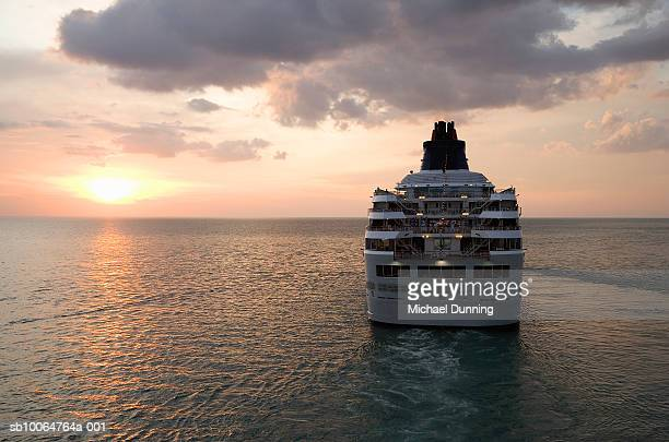 cruise ship in sea at dusk - cruise stock pictures, royalty-free photos & images