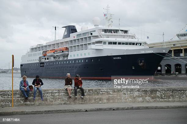 A cruise ship is docked at the marina near the historic Habana Vieja or Old Havana neighborhood March 21 2016 in Havana Cuba Although diplomatic...