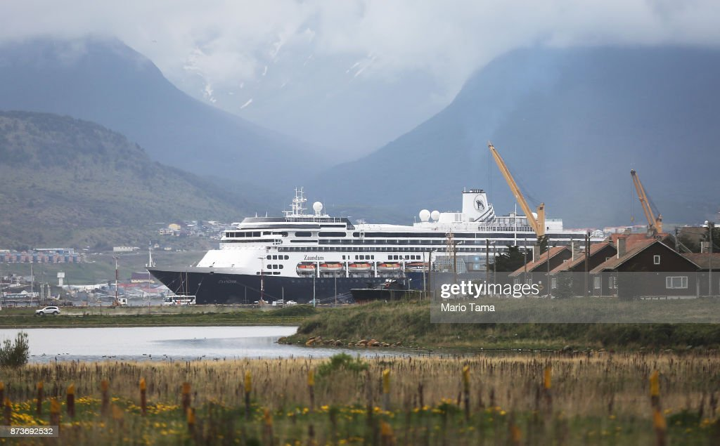 A cruise ship is docked next to old homes (R) on November 11, 2017 in Ushuaia, Argentina. Ushuaia is situated along the southern edge of Tierra del Fuego, in the Patagonia region, and is commonly known as the 'southernmost city in the world'. The city's main fresh water supply comes from the retreating Martial Glacier, which may be at risk of disappearing. In a 2015 report, warming temperatures led to the loss of 20 percent of the mass and surface of glaciers in Argentina over the previous 50 years, according to Argentina's Institute of Nivology, Glaciology and Environmental Sciences (IANIGLIA). Ushuaia and surrounding Tierra del Fuego face other environmental challenges including a population boom leading to housing challenges following an incentivized program attracting workers from around Argentina. Population in the region increased 11-fold between 1970 and 2015 to around 150,000. An influx of cruise ship tourists and crew, many on their way to Antarctica, has also led to increased waste and pollution in the area sometimes referred to as 'the end of the world'.