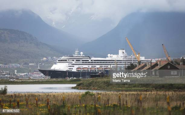 A cruise ship is docked next to old homes on November 11 2017 in Ushuaia Argentina Ushuaia is situated along the southern edge of Tierra del Fuego in...