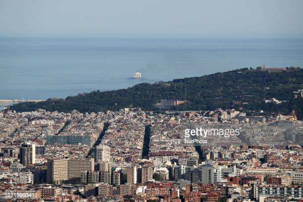A cruise ship leaving the port of Barcelona Barcelona reaches historic lows in air pollution on 06th May 2020